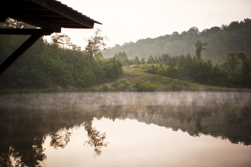 Scenic view of lake in morning mist