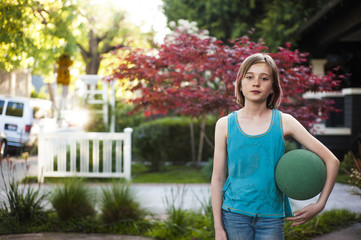 Girl (10-11) with ball under arm