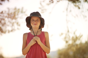 Girl (8-9) with hat smiling