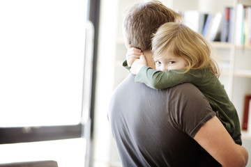Portrait of daughter embracing father at home