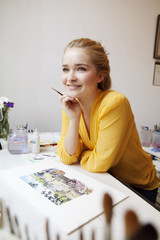 Young woman smiling in art studio