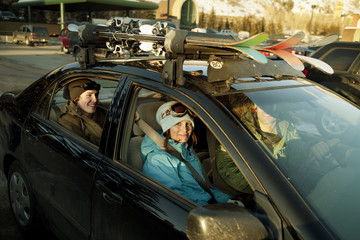 Friends gathered in car for skiing trip
