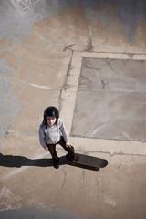 Girl (8-9) on skateboard