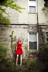 Woman in red dress standing in yard
