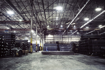 Girders stacked in warehouse