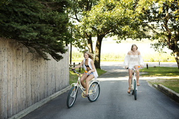 Happy friends cycling on road