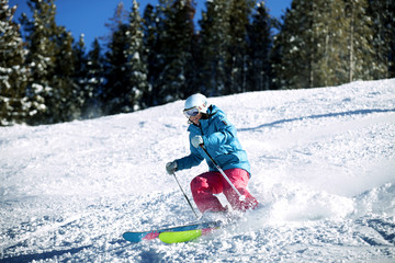 Young woman skiing on sunny day