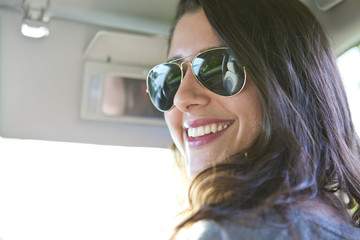 Woman smiling in front seat of car