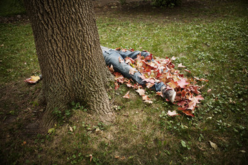 Man laying in pile of leaves