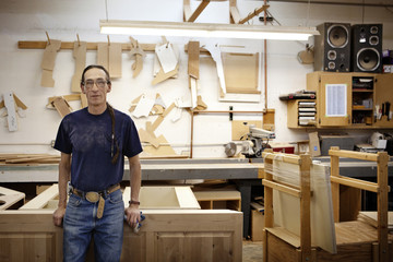 Portrait of carpenter standing in woodshop