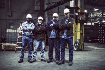 Four workers in warehouse