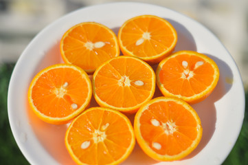 Top view of fresh sliced orange close-up on plate