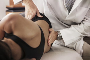 Physical therapist massaging patient