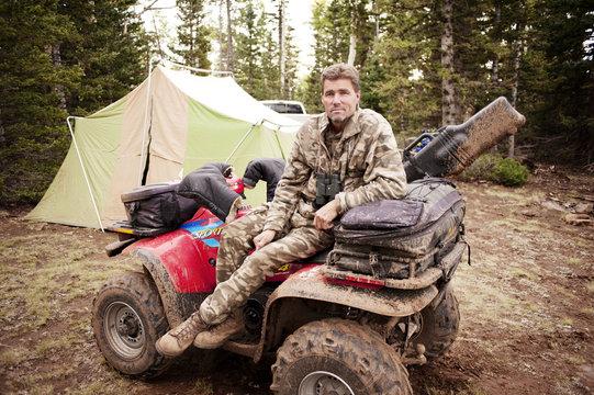 Man in camouflage sitting on ATV