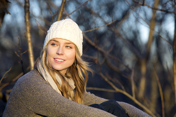 Young woman sitting alone with white beanie
