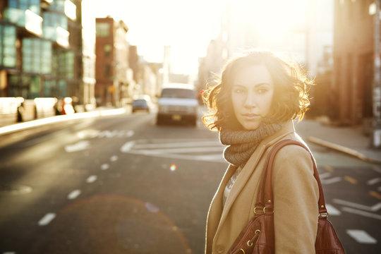 Portrait of woman crossing street