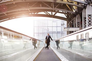 Man standing on escalator at subway station