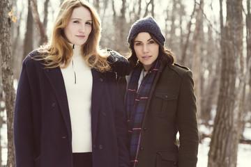 Two women in forest in winter