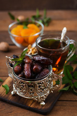 Mix dried fruits (date palm fruits, prunes, dried apricots, raisins) and nuts, and traditional Arabic tea. Ramadan (Ramazan) food.