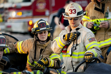 Firefighter talking on two way radio outdoors