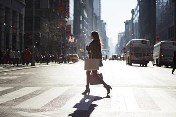 Side view of woman walking on zebra crossing