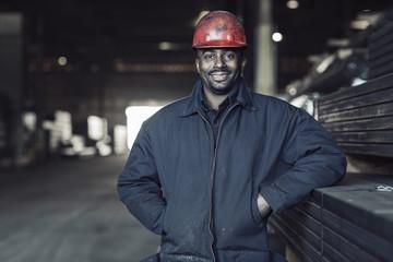 Portrait of worker standing in factory