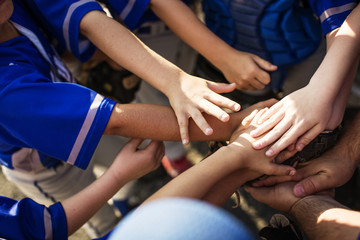 High angle view of baseball players huddling