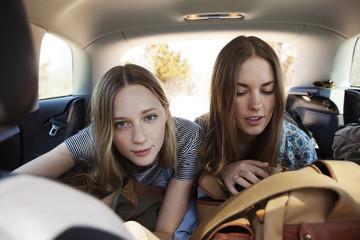 Friends sitting in car