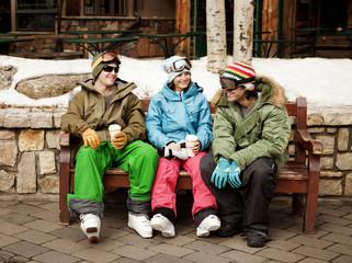 Three friends taking break from skiing