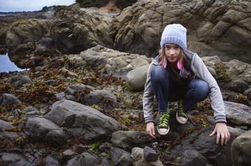 Portrait of girl (10-11) exploring beach