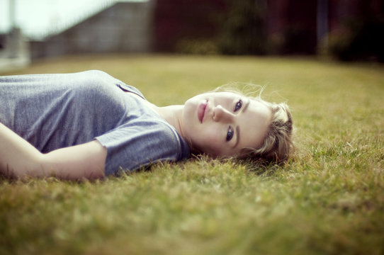 Young beautiful woman lying on the grass