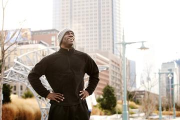Man taking break from running in city