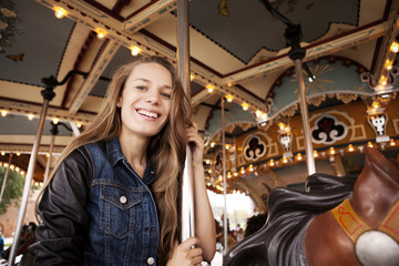 Portrait of young woman on merry go round