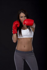 Kick box long dark hair beautiful girl with red gloves on her hands