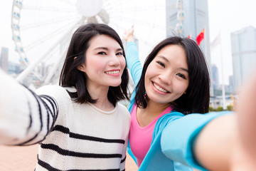 Two women taking selfie together in Hong Kong