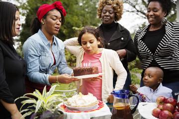 Family celebrating birthday party outdoors
