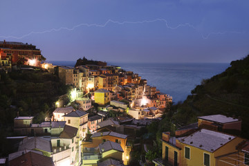 High angle view of illuminated houses against sea