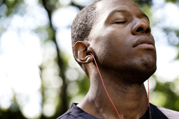 Close-up of man with eyes closed listening music
