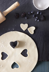 High angle view of heart shape pastry cutter on dough