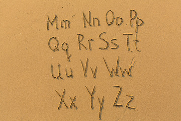 Alphabet letters drawn on beach sand (M-Z, 2/2)