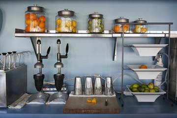 Fruits with juice makers on kitchen counter