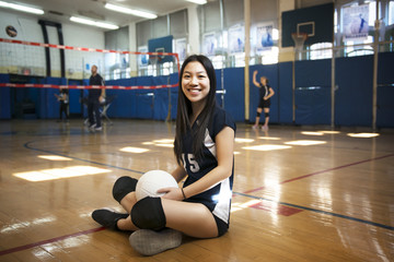 Portrait of teenage girl with volleyball