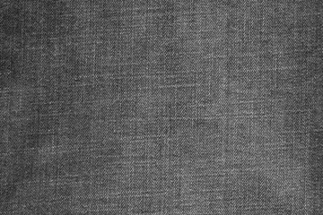 textured background from denim of dark gray color