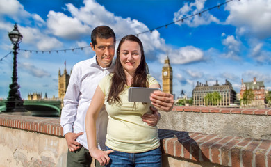 couple making the selfie photo in London