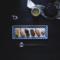 Overhead view of various sushi arranged in plate