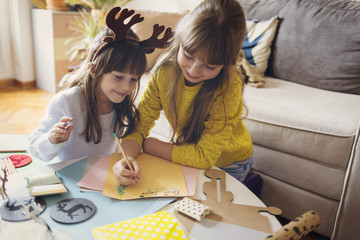 Two girls writing letter to Santa