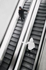 Young people on escalator