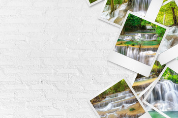 Huai Mae Kamin waterfall polaroid photo on white wall.