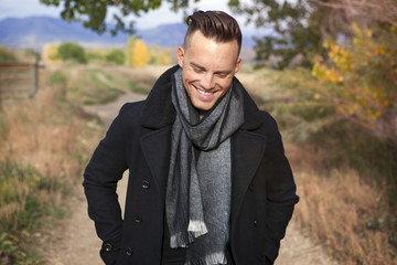 Smiling young man wearing scarf