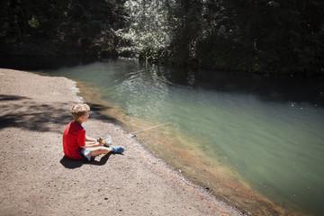 Boy fishing in rover
